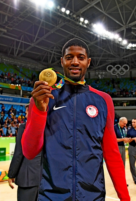 RIO DE JANEIRO, BRAZIL - AUGUST 21:  Paul George #13 of the USA Basketball Men's National Team celebrates after winning the Gold Medal Game against Serbia on Day 16 of the Rio 2016 Olympic Games at Carioca Arena 1 on August 21, 2016 in Rio de Janeiro, Brazil. NOTE TO USER: User expressly acknowledges and agrees that, by downloading and/or using this Photograph, user is consenting to the terms and conditions of the Getty Images License Agreement. Mandatory Copyright Notice: Copyright 2016 NBAE (Photo by Jesse D. Garrabrant/NBAE via Getty Images)