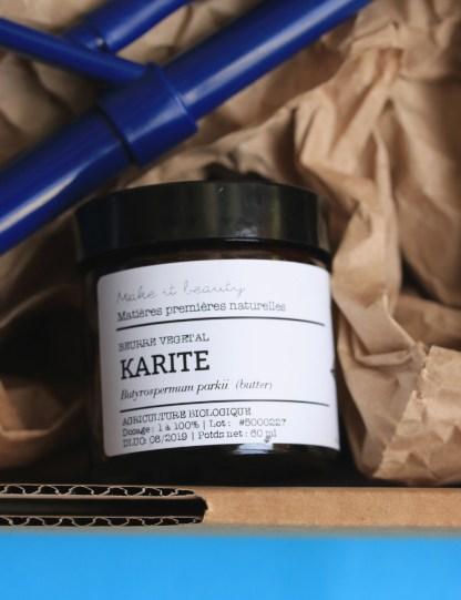 beurre de karité bio dans un pot env erre ambré avec couvercle noir