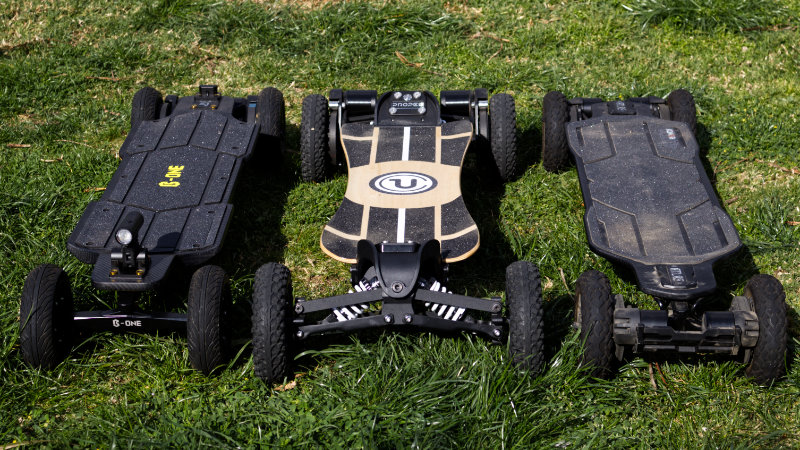 Three Off-road electric skateboards side-by-side