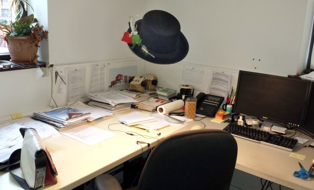 Poor Francisco! His desk-ghost keeps stealing his hat.