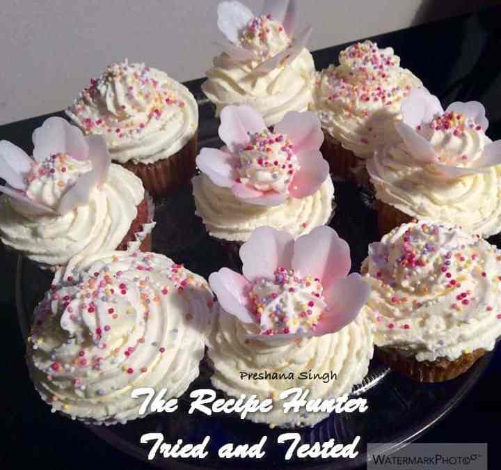 Preshana's Cupcakes with fresh cream, wafer petals and sprinkles
