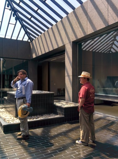 Architectural historians Richard Schave and Nathan Marsak in the Peirera corporate HQ atrium