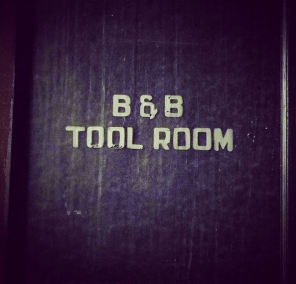 Down a dark hall is a former tool room, vacant now.