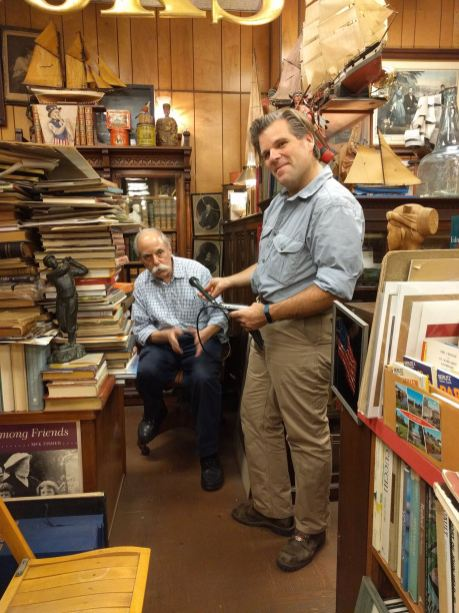 Leonard in his bookshop being interviewed