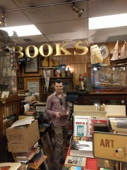 Craig Sauer finds a clear spot to scan the back corner of Caravan Book Store