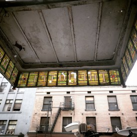We remember when a truck did this bit of damage to the stained glass, which somehow hangs on