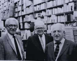Louis Epstein (proprietor of PIckwick Books), Edwin Stackhouse (manager of Pickwick Books), and bookdealer, Jake Zeitlin (left to right) in the aisles at Pickwick Books.