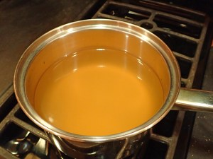 Pour chicken broth into a saucepan