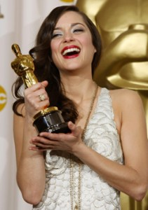 France's Marion Cotillard holds Oscar she won for best actress at the 80th annual Academy Awards in Hollywood