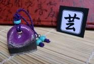 Sello Hanko Arte en gres negro esmaltado en lila