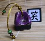 Sello Hanko Reir en gres negro esmaltado en lila
