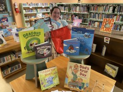 Librarian Tiffany Flores with backpack and books