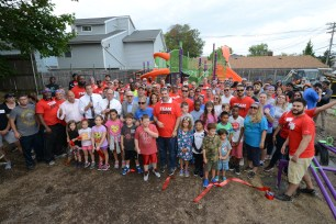 Over 200 volunteers from ESPN, Disney, Samuel Field Y, area residents and KaBOOM! helped transform an empty lot into a kid-designed play space in less than eight hours in Little Neck, NY. (Photo by Lorenzo Bevilaqua / ESPN Images)