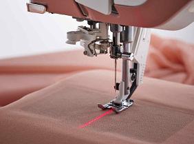 Säädettävä ompeluohjaus lasertekniikalla