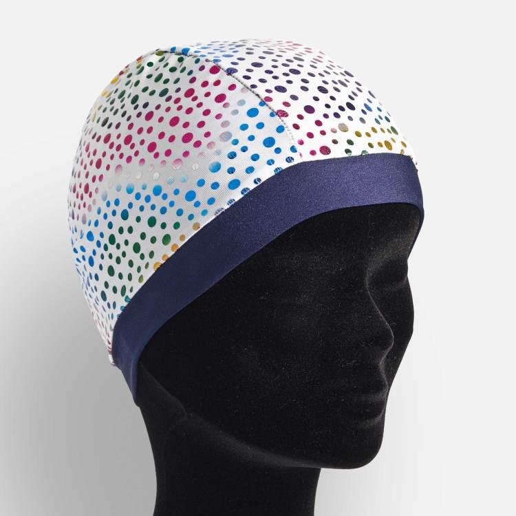 bonnet de bain blanc à pois multicolors bordé de bleu marine