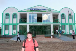 Team member Mike Cillo poses in front of New Hope Hospital