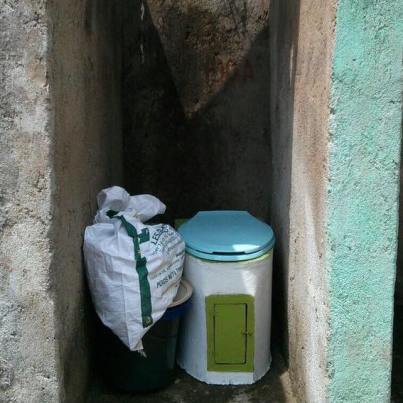 The SOIL toilet along with the supplies needed to maintain it. Can easily be placed inside a home