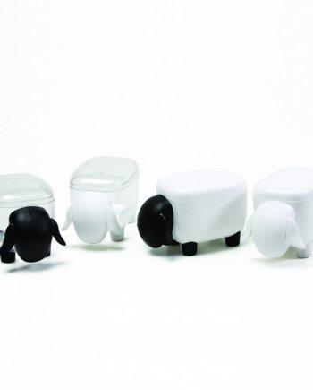 caixas em forma de ovelha pretas e brancas