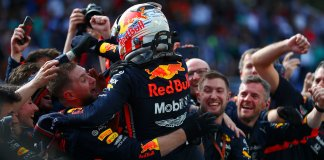 Max Verstappen celebrating with his team after a historic win at the Säo Paulo circuit. Image sourced from @RedBullRacing via Twitter.