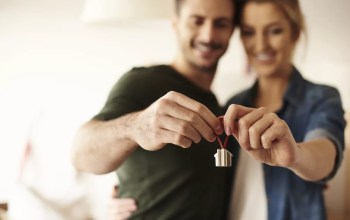 Couple holding house keychain in hands