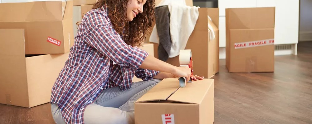 Woman packing moving box