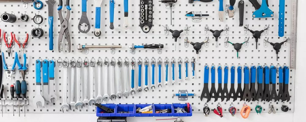 Organized workbench with tools hanging from pegboard