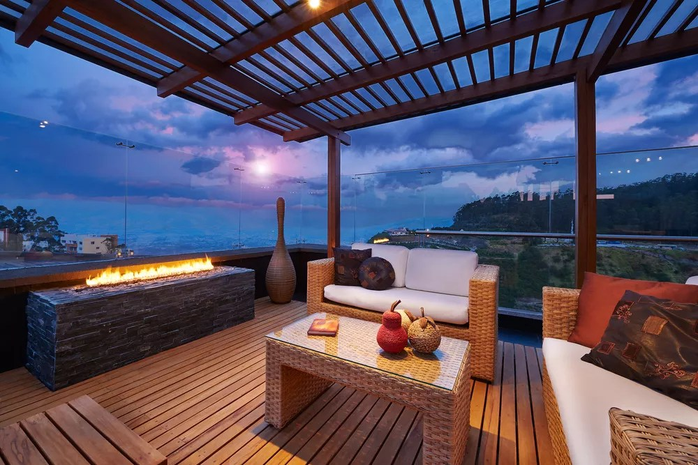 Outdoor living room on patio with pergola and fire pit