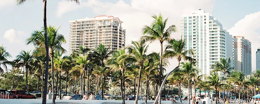Beach in Miami, FL with condominiums in the background