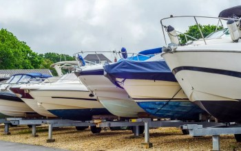 Row of boats in outdoor storage