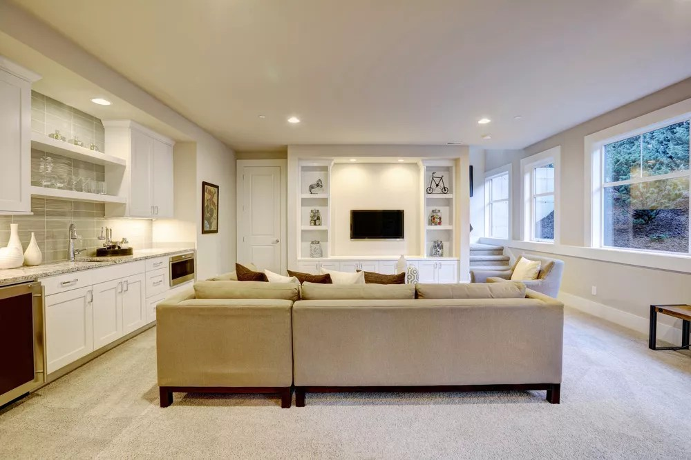 Organized basement with tan couch