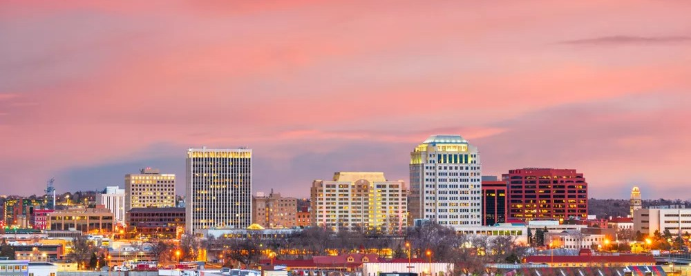 Skyline of tall buildings in Downtown Colorado Springs at sun rise