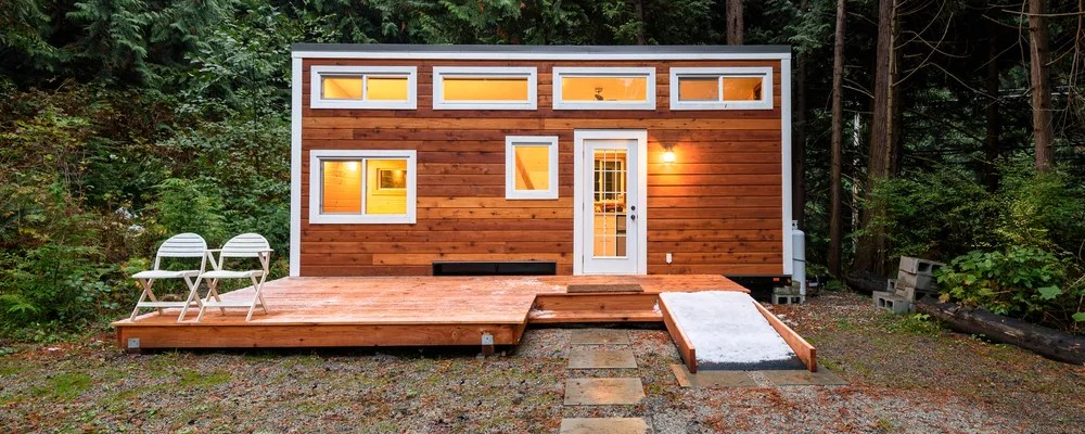 Wood tiny home with white trim.