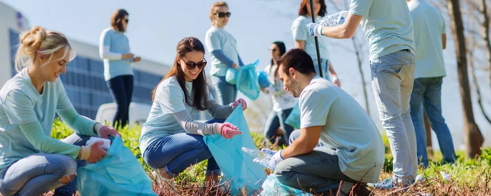 Group of volunteers cleaning up neighborhood