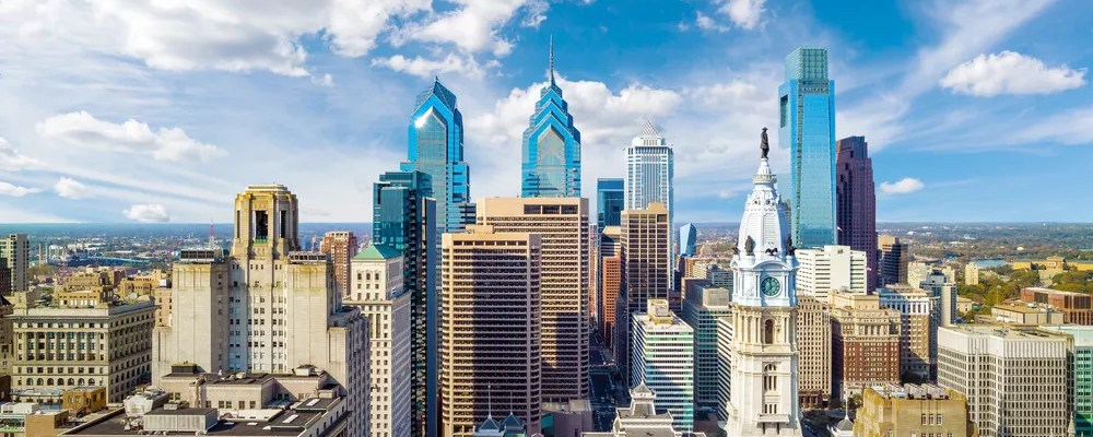 Skyline of tall buildings on sunny day in Downtown Philadelphia