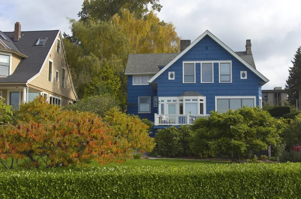 blue home with white shutters and nice landscaping in Seattle, WA