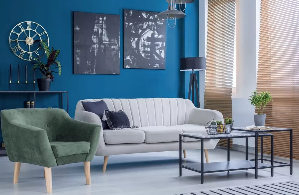 Simple living room with gray couch and green chair