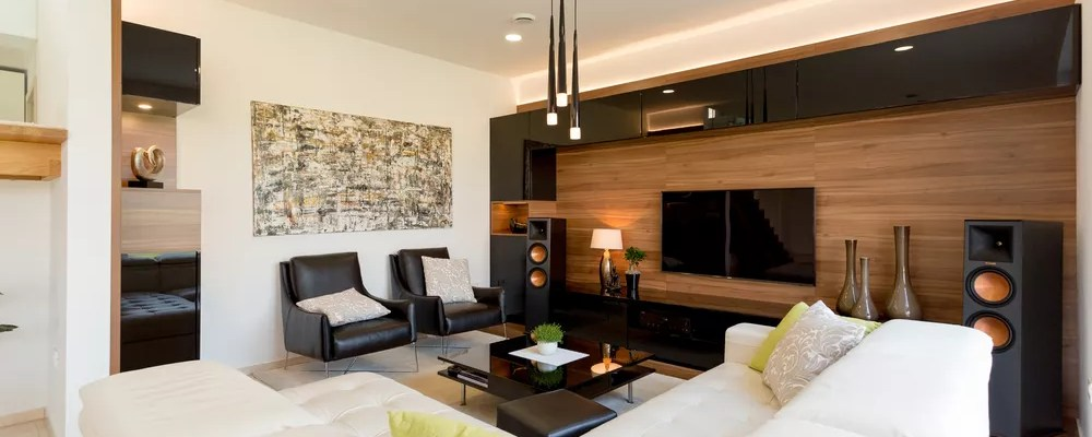 Simple Living Room Setup with White Couch and TV on the Wall