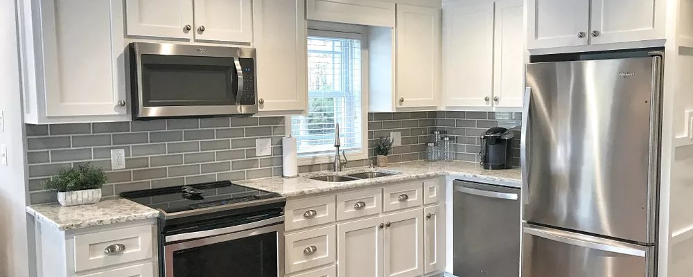 Updated Kitchen with White Cabinets, New Hardware, and Energy Saving Appliances