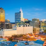 Aerial view of downtown Raleigh, NC at dusk.