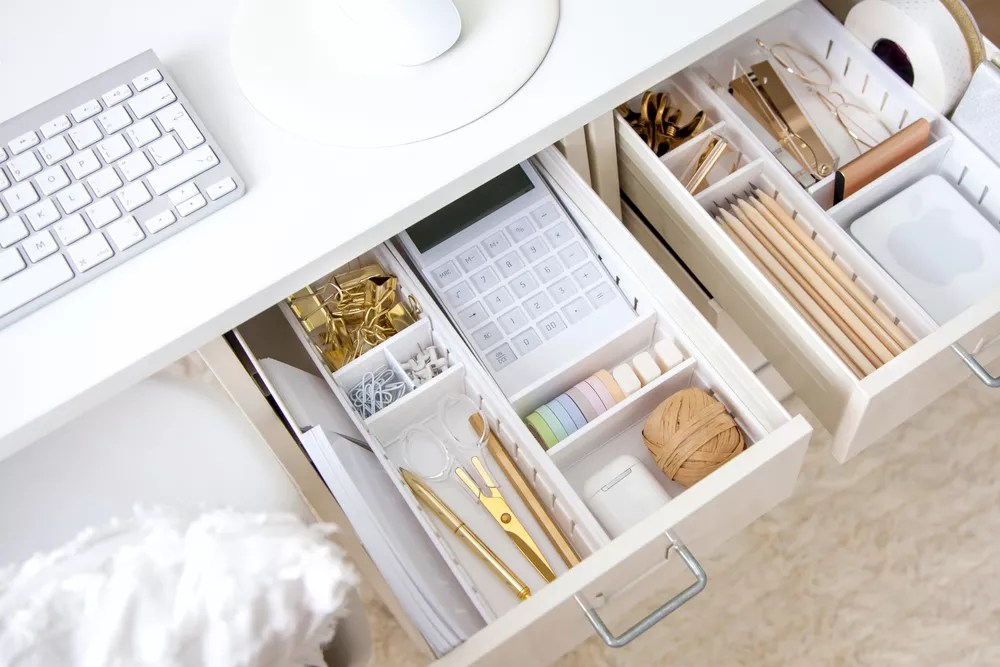 Junk drawer organized with dividers
