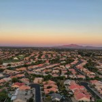 Aerial shot of Chandler, AZ suburbs with mountain view.