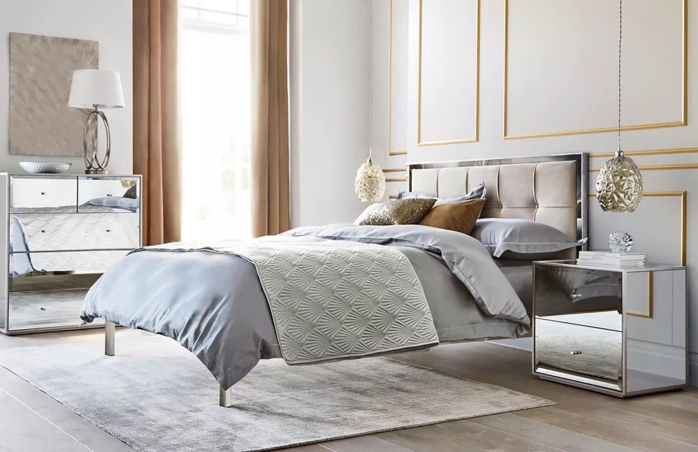 Modern gray bedroom with upholstered headboard
