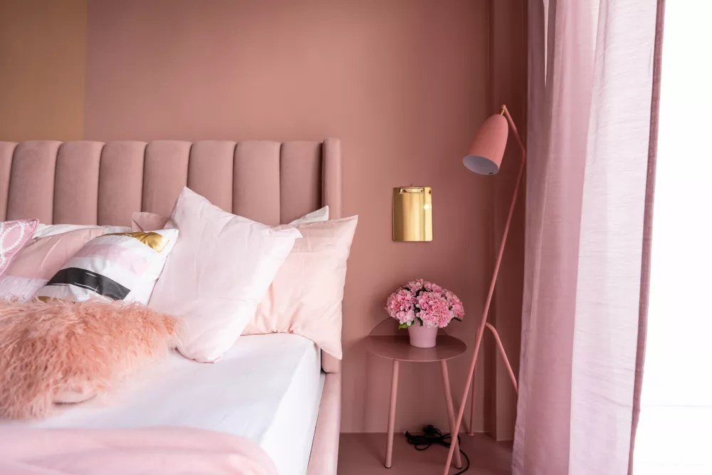 Updated Bedroom with Pink Walls and Pink Accent Furniture