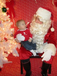 Santa Visits Mary's Place. This little guy learned to walk last year in the Mary's Place Family Room.