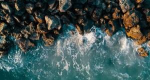 Waves crash onto a rocky shore