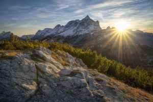 The sun rises over a mountain range