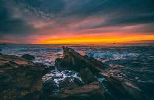 A rocky beach at sunset