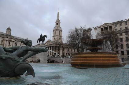 The fountain of Trafalgar Square and the church of St Martin's in the Fields