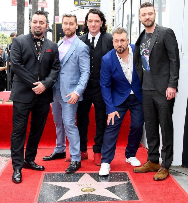 *NSYNC pose next to their star on the Hollywood Walk Of Fame. Photo credit *NSYNC Instagram.