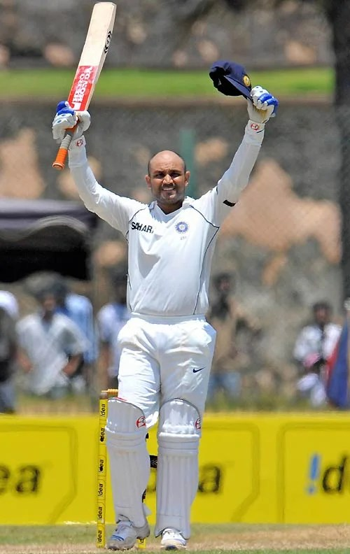 Sehwag carrying his bat